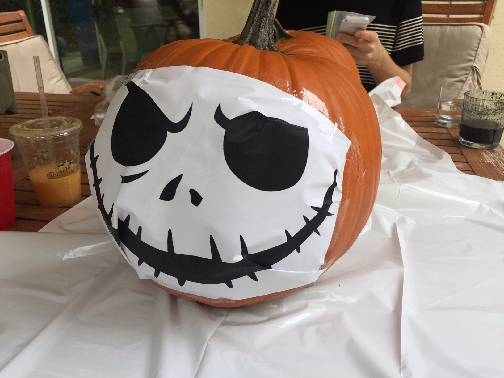 i went online and googled jack skellington halloween stencil i printed it out taped it to my pumpkin and began to carve away